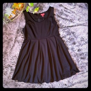 Black cocktail dress by Elle.